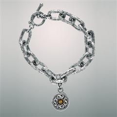 Sterling silver link bracelet with charm.  Arista.