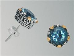 #306. Sterling silver stud earrings with 18K gold accents and blue topaz.