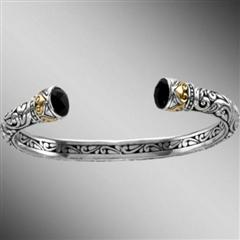 Open sterling silver bangle bracelet with onyx terminals.  Arista.