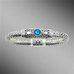 Woven silver bracelet with swiss blue topaz and magnetic clasp.  Arista.