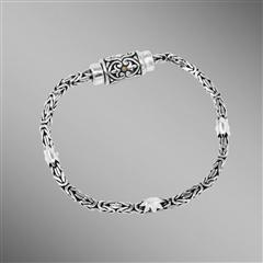 Sterling silver byzantine chain bracelet with magnetic clasp.