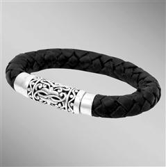 Thick braided leather bracelet with silver magnetic clasp.